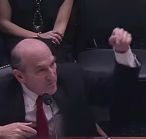 Elliott Abrams protests